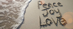 peace joy love on sandy beach