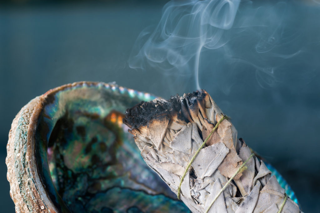 smudging sage smoking with abalone shell