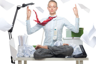 stressed woman on desk