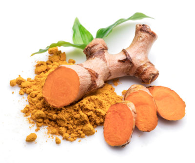 turmeric root and powder on table
